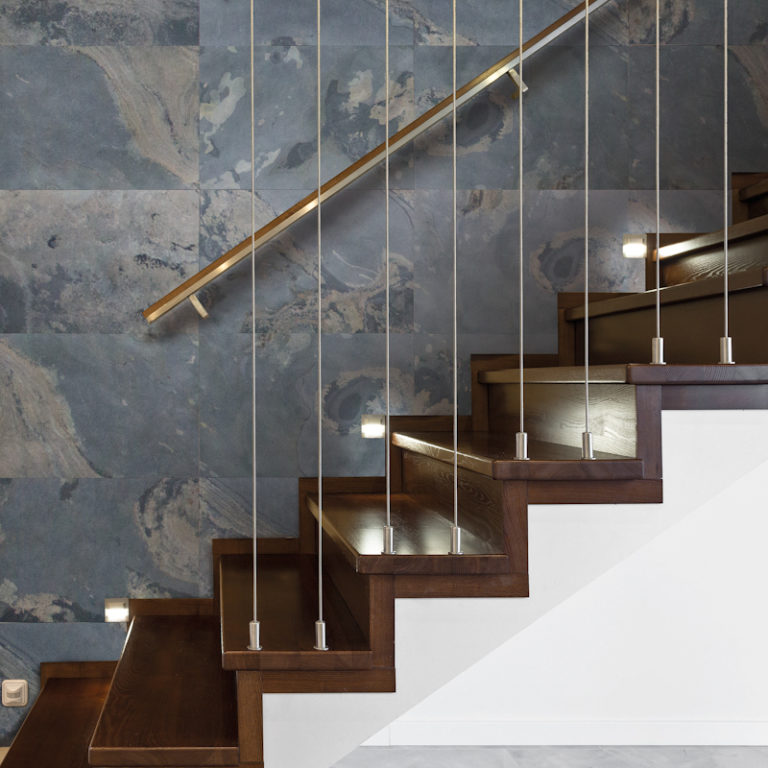 Wooden stairway and brick wall in luxury anteroom