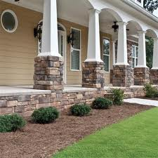 Building a home with a stone siding porch